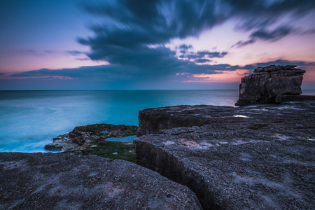 timelapse: Motion moving clound at sunset at rocky cliffs in Dorset, UK.