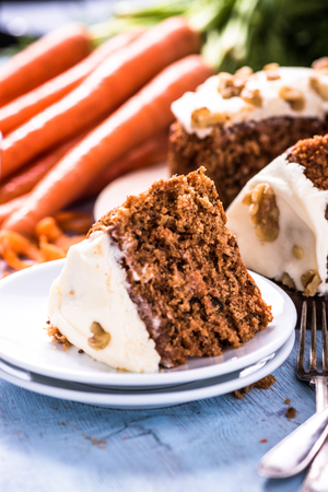 carrot cake: Slice of carrot cake, view from above on wooden table. Homemade healthy food.