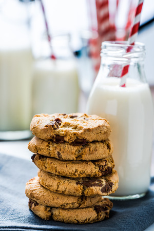 diet product: vintage milk bottle with striped red straw and homemade cookies Stock Photo