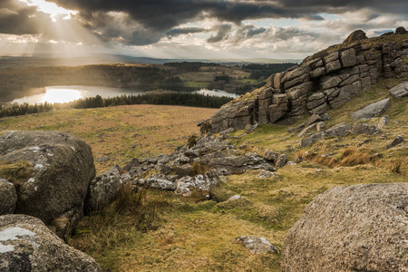 granite park: Landcape panoramic view from summit, dramatic sky over lake.  Granite rocks formation in Dartmoor National Park,UK.