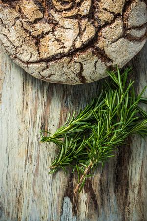 artisan bakery: Home baked rye bread and fresh rosemary