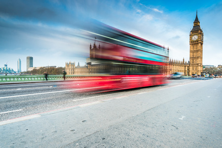 morning blue hour: Big Ben and landmark bus on Westminster Bridge in London at early morning blue hour Stock Photo