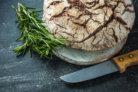 artisan bakery: Home baked bread, food border background, dark slate with copy space