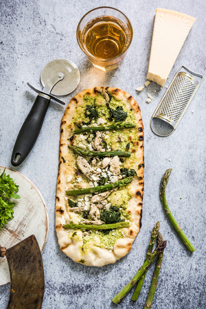woodfired: Homemade artisan pizza with asparagus, fresh herbs and parmesan Stock Photo