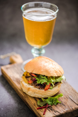gastro: traditional gastro pub food, bbq beef bun with local beer Stock Photo