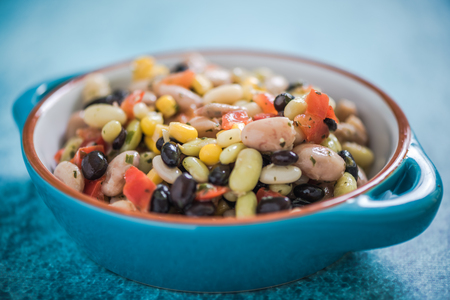 borlotti beans: mixed beans salad in blue bowl Stock Photo