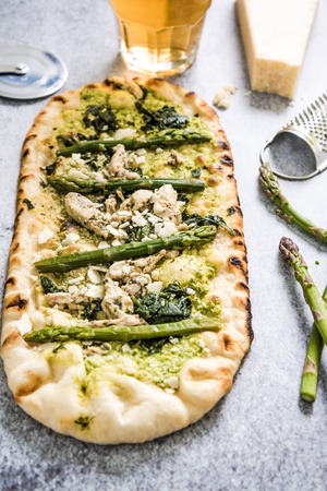primavera: Pizza primavera from above, with asparagus and fresh herbs Stock Photo