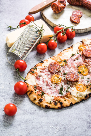 woodfired: Traditional stone ovew baked pizza with ingredients on slate background Stock Photo