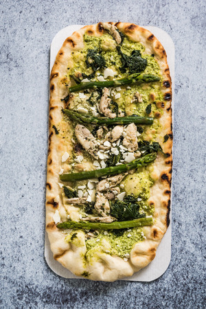 woodfire: Woodfire baked artisan pizza with asparagus and chicken