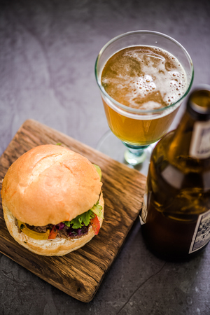 gastro: serving beef burger with local artisan Ale beer, gastro pub Stock Photo