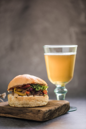 gastro: BBQ beef bun and glass of Ale local beer or cider Stock Photo