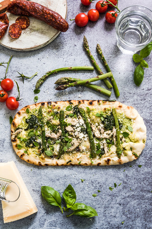 woodfired: Pizza for sharing, from above on slate background, flat lay ingredients