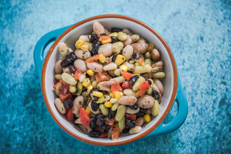 mixed beans salad in blue bowl Archivio Fotografico
