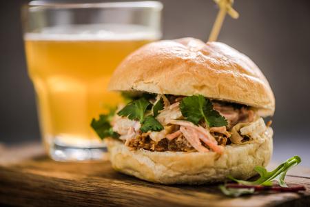 bap: serving pub food, pork bap with coleslaw, on wooden board with cider