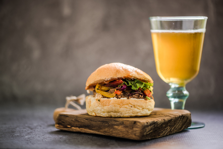 bap: BBQ beef bun and glass of Ale local beer or cider Stock Photo