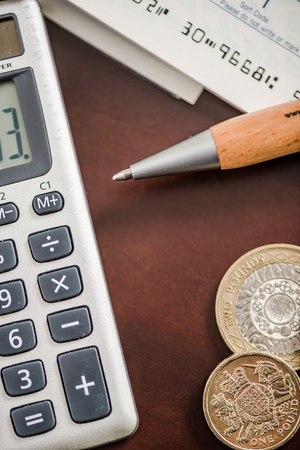 paying money: paying money and book keeping concept on office desk