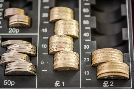 sterling: Pound sterling coins in cash register, from above view