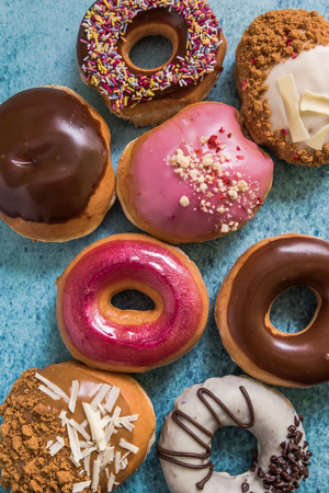 downwards: hand glazed artisan donuts, flat lay downwards view