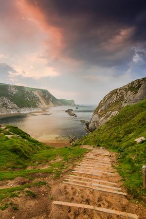dorset: steps into wilderness, Dorset beach in Jurassic coast Stock Photo