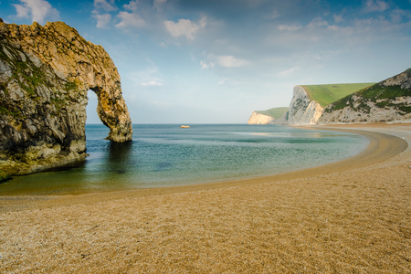 durdle door: panoramic view over durdle door beach, white cliffs and clouds Stock Photo