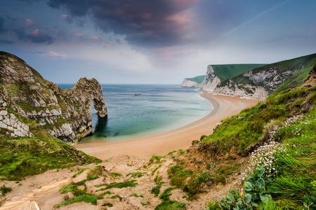 durdle door: panoramic view over beach with Durdle Door landmark in Dorset Jurassic Coast, UK