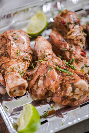 marinate: chicken drumstick in marinate for bbq at garden picnic
