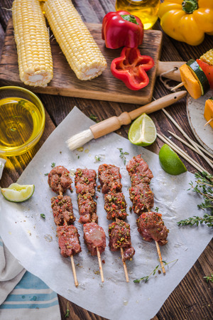 marinate: marinate beef kebabs on wooden table for barbecue