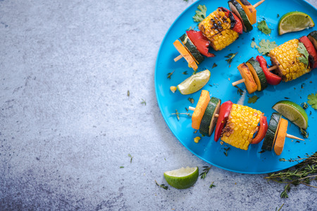 haloumi: vibrant helthy bbq food, border background, flat lay top view