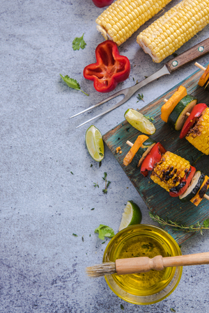 haloumi: ingredients for healthy bbq or grill, on marble top, flat lay, view from above
