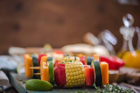 haloumi: vegetable skewers, copy space wooden background