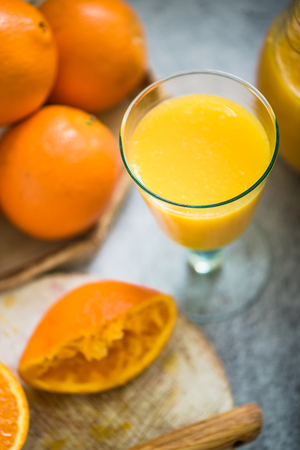 squeezed: fresh squeezed orange juice from fruits Stock Photo