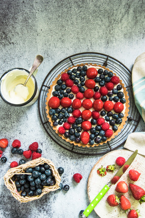 crust: summer berry fruits tarta on crust with creme