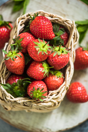 freshly picked: fresh strawberries in wicker basket, freshly picked