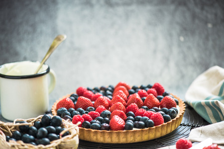 close view on berry tarta, with british national flag on top Stock Photo