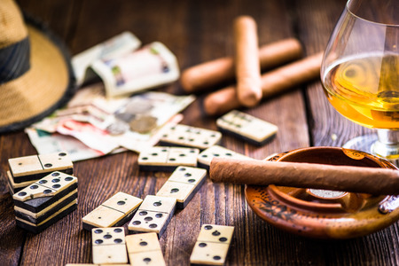 cuban culture: cuban cigar and domino on table, from overhead Stock Photo