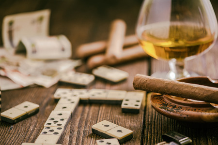 cuban culture: cuban traditional domino game, cigar and cognac