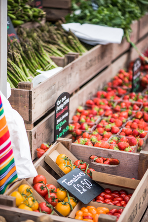 local festivals: fresh tomatoes at farmer local market stall