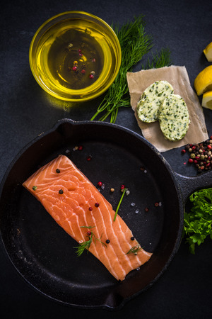 heathy: fresh salmon , herbs spices and rustic pan, heathy dinning concept