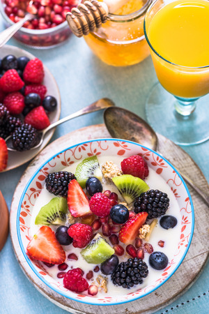 pommegranate: berries,kiwi, pommegranate seed in bowl, healthy breakfast concept Stock Photo