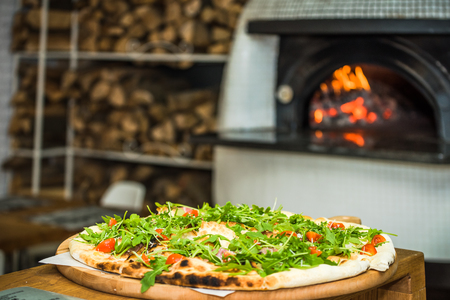 vegeterian: vegeterian pizza with traditional wood fired oven in background
