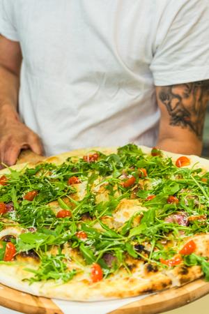 vegeterian: restaurant chef hold vegeterian traditional pizza
