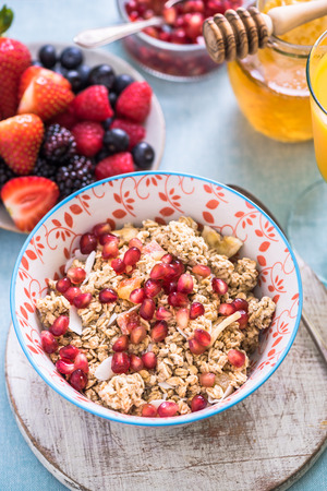 pommegranate: granola bowl with pommegranate seeds, healthy breakfast