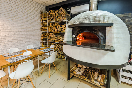 fast food restaurant: wood fired pizza stove in traditional italian restaurant