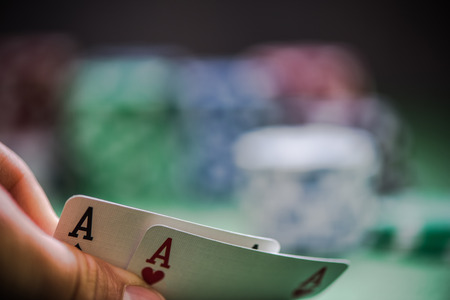 lear: man shows two aces in poker game in casino Stock Photo