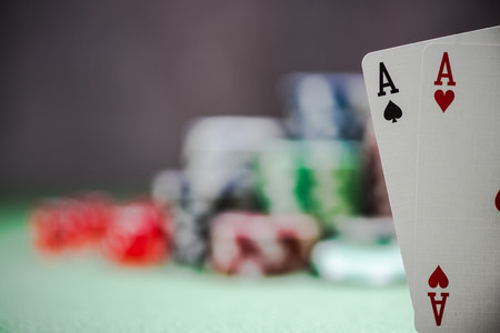 holdem: two winning aces in poker, casino background