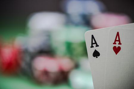 lear: strong cards in poker game in casino
