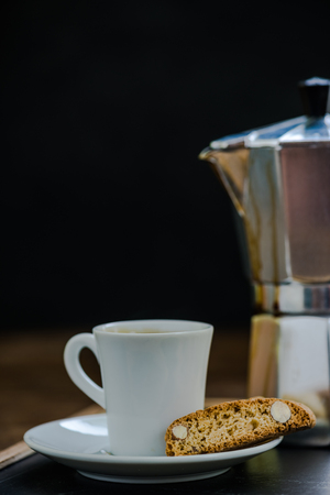 moody background: morning coffee with cake, dark moody background