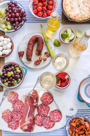 sharing food: authentic spanish tapas, on table from above, sharing food