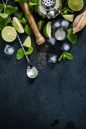 ingredients for cuban mojito cocktail on dark slate