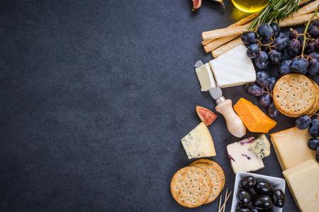 cheese selection border background on dark slate